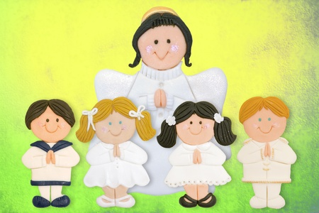 cheerful first communion card, funny kids and angel made of sugar photo