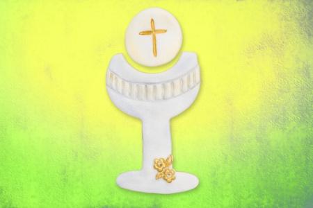 c�liz y la hostia linda la primera comuni�n, en el fondo de colores Foto de archivo - 12049888