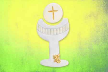 chalice and wafer cute first communion, on colorful background photo