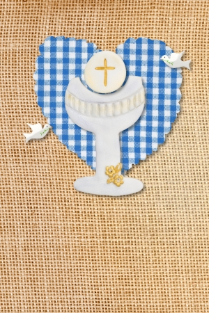 wafer: cute card first communion, chalice in burlap rustic background Stock Photo