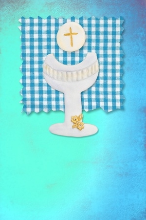 vertical card first communion, cute chalice and wafer for boys photo