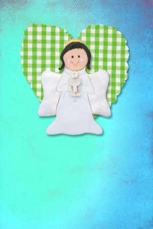 cheerful first communion card, angel and heart on blue background photo
