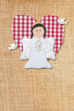cheerful first communion card, angel in burlap background photo