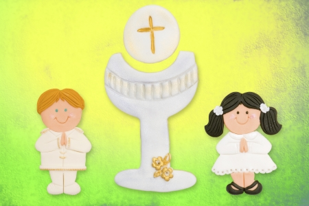 first communion card funny, dark-haired girl and blond boy chalice photo