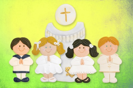cheerful first communion card, a group of children and goblet made ??of sugar photo