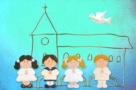 blue church: cheerful child card first communion, church and group of children made ??of sugar on blue background Stock Photo