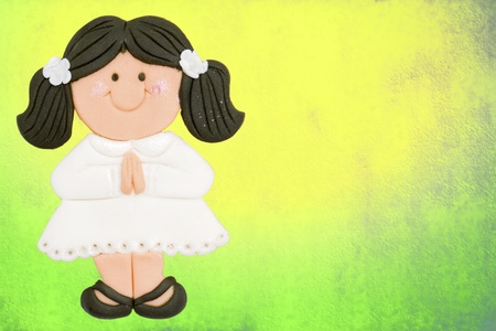 greeting invitation card, first communion girl brown, colorful background photo