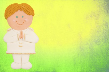 greeting invitation card, first communion, cute blond boy, colorful background photo
