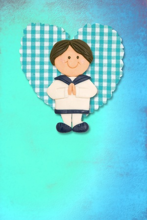 First Holy Communion Invitation Card, cute brunette boy on blue background photo