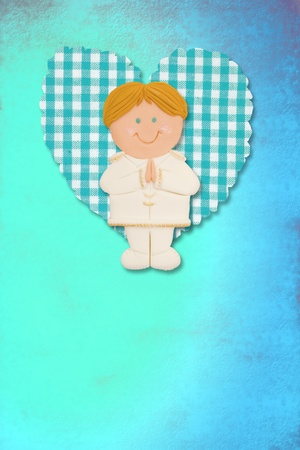 First Holy Communion Invitation Card, cute blonde boy on blue background photo