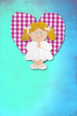 First Holy Communion Invitation Card, cute blond girl on blue background photo