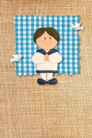 First Holy Communion Invitation Card, rustic style, funny brunette boy in burlap background Stock Photo - 12379806