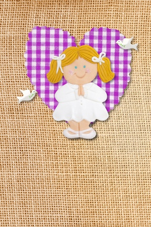 First Holy Communion Invitation Card, rustic style, funny blond girl in burlap background Stock Photo - 12379807