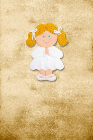 vertical card first communion, funny blond girl in parchment background photo