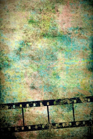 transparent negative film by old vertical grunge wall Stock Photo - 12379825
