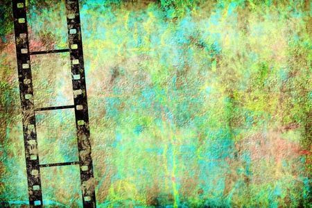 transparent negative film by old grunge wall with copy space photo