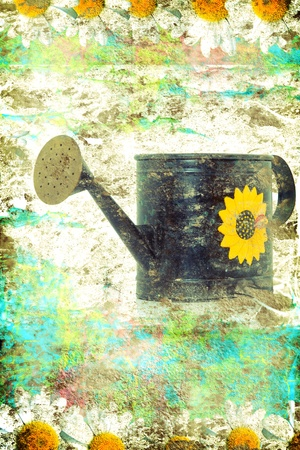 Aged metallic watering can grunge background photo