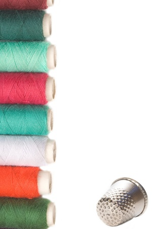 spools of thread and thimble for sewing on white background Stock Photo - 12379830