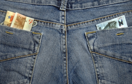 Jeans with money in their pockets Stock Photo - 14014308