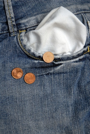 Three cents of euro falling from jeans, concept of crisis   photo
