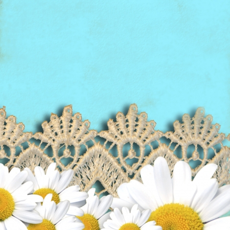 cheerful turquoise background with daisies and lace, copy space photo