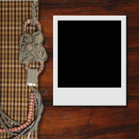 empty  photo frame on wooden background, vintage style photo