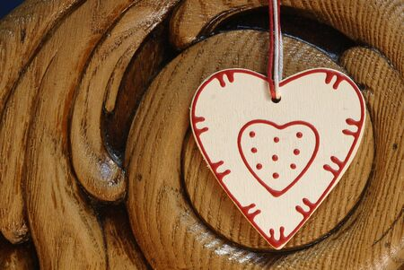 country heart  on wooden background photo