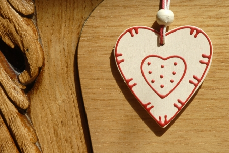 sweetheart: rustic heart heart hung on wooden door