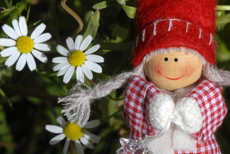 troll dolls: christmas card, cheerful santa claus elf girl with daisies