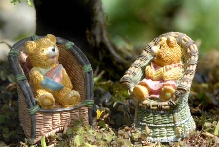 baby boy and girl teddy bears sitting on the countryside photo