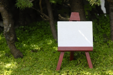 blank easel in the countryside Stock Photo