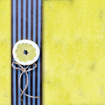 yellow background with lemon slice and copyspace photo