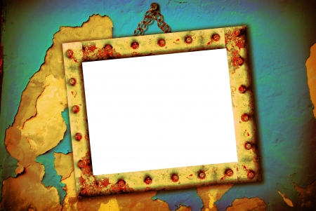 Empty frame hanging on a broken wall, urban style photo