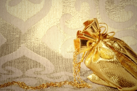 background gift sack with gold gilding photo