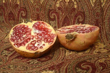 half open: pomegranate in half open vintage background Stock Photo