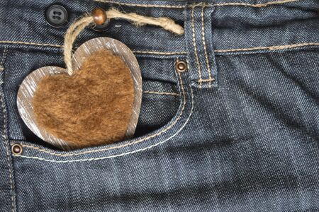 wooden heart in jeans pocket photo