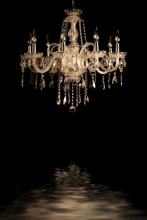 Contemporary glass chandelier isolated over black background Stock Photo