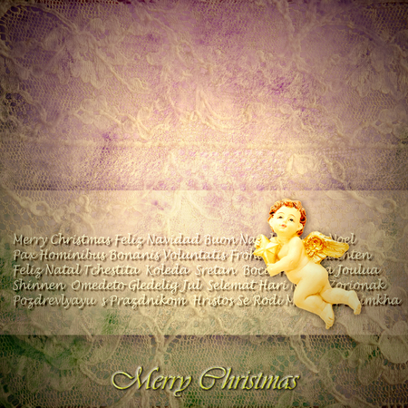 Vintage style Christmas greeting, Angel on a background of old lace and Merry Christmas in many languages