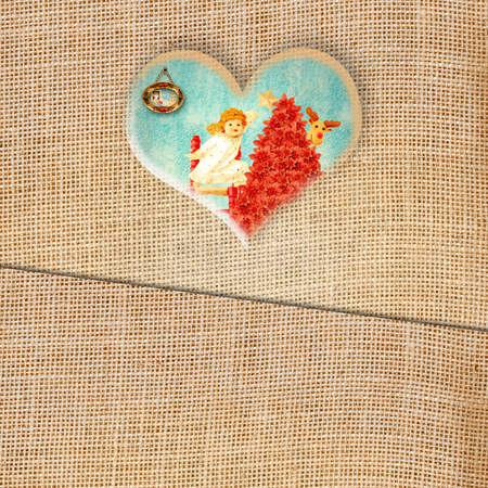 Funny Christmas greeting card, lovely Angel in heart on burlap background photo