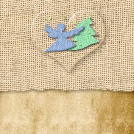 christmas card, fir and angel burlap  in a transparent heart, copy space photo