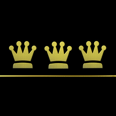Christmas card Three Wise Men, golden metallic crowns in black background with copy space photo