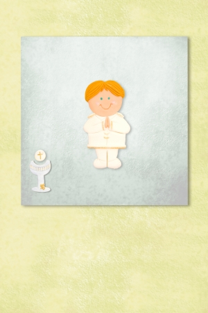 boy celebrating first communion invitation card, Background with copy space. photo