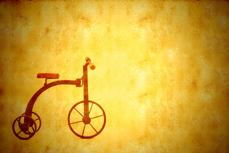 background vintage bicycle tricycle antique background texture with empty space on parchment paper photo
