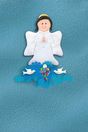 first communion invitation cheerful angel and Chalice  with empty space for data from children photo