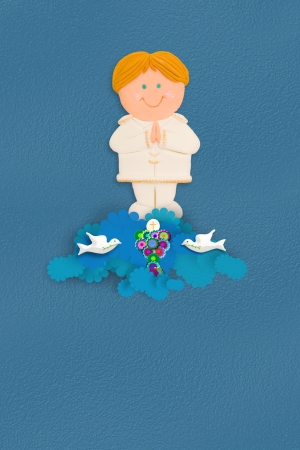 child's: Cute blond boy first communion chalice on blue background with space for writing name and date Stock Photo