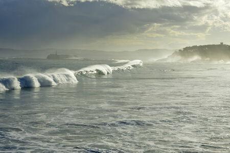 santander: Waves in the bay of Santander Spain The Palacio de La Magdalena and Island Mouro