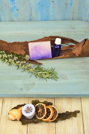 background natural soap rosemary oil salt and flavorings in rustic wooden background photo