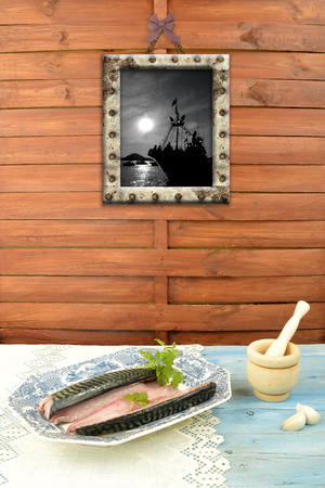 bluefish: Raw fish ready to cook in the kitchen and decorated sailor