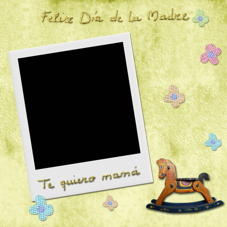 dia de la madre: Sentence feliz dia de la madre te quiero mama, happy mothers day love you mom in spanish, Instant Photo Frame in yelow child background with antique toys  Stock Photo
