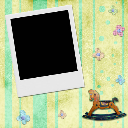Instant photo frame in chid background with flowers and rocking horse photo